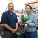 Isaac Vega and a volunteer at the Claremont Satellite Food Pantry.