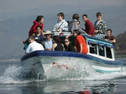 High school students from Canada on a research boat on a lake as part of a Guatemala Expedition.