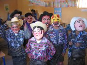 Boys at a small rural school playing with traditional masks during a Guatemala Expedition.