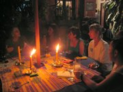 Visitors from the US enjoy a candlelit dinner with locals in Antigua Guatemala.