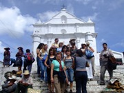 Educators from Colorado standing in front of a Spanish Colonial Church in Chichicastenango Guatemala.