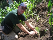 University professor planting trees during a service learning trip to Guatemala.