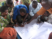 Participants in a blended training program leading Community members in a participatory needs assessment in Tanzania.