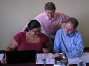 Tim Magee consulting with two non profit clients.